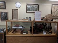 Photo of display case containing Kinsman historical artifacts